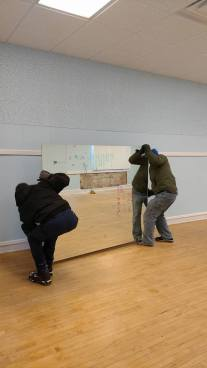 Moving donated mirrors into studio